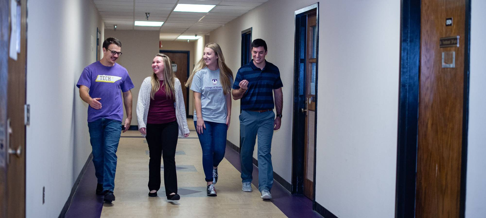 Students walking down a hall in Johnson Hall