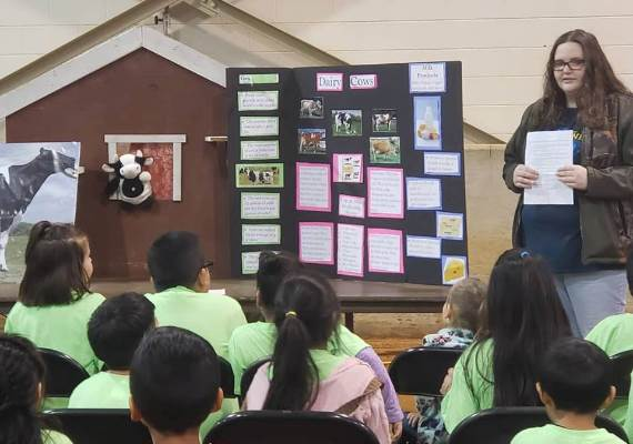 A student teaches at Farm Day event