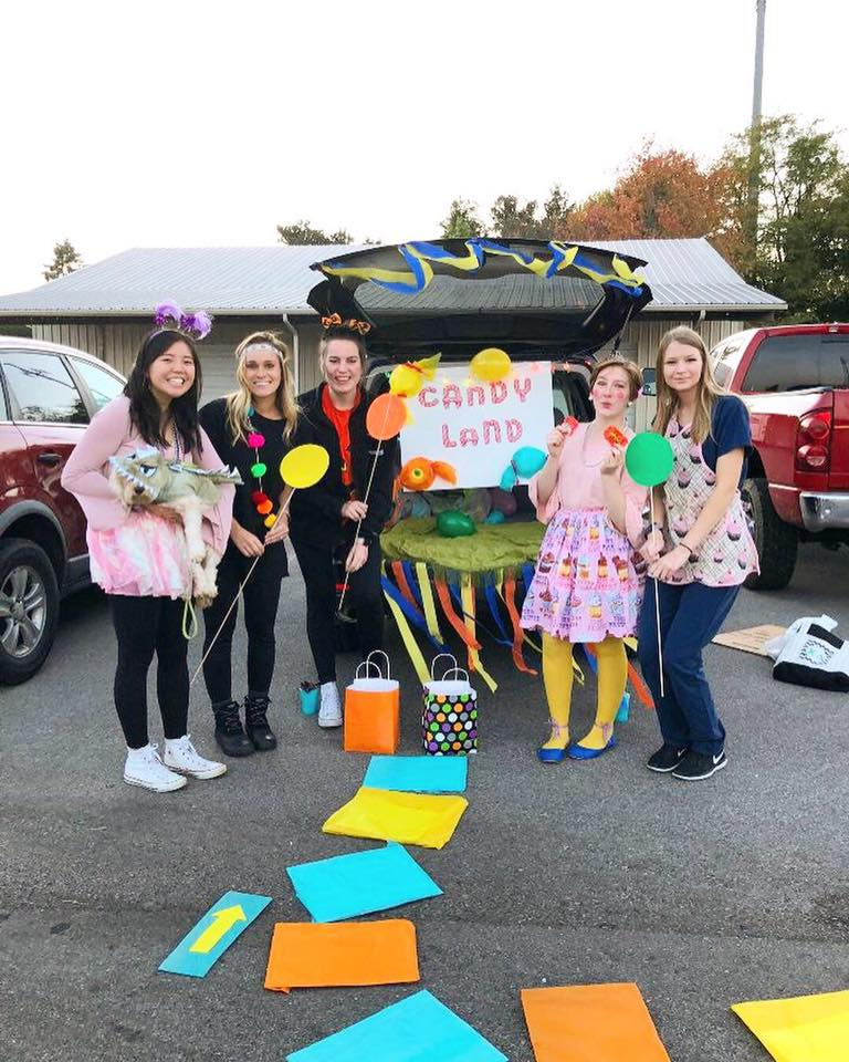A student club participates in a trick or treating activity for a local women's shelter.