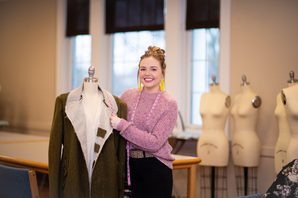 A fashion student shows off a design