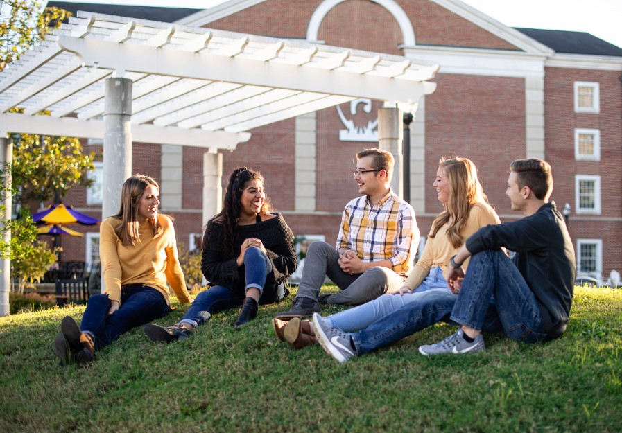 Five students sitting outside Centennial Plaza at Tennessee Tech