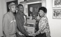 Students (on the left) assisting with creating a display for the BCC, wearing classic urban street style and athletic silhouettes, 1992