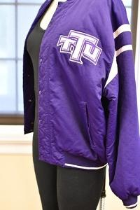 From Historic Costume Collection, Mid-1990s TTU Varsity Jacket and Leotard, as commonly worn by The Fly Girls