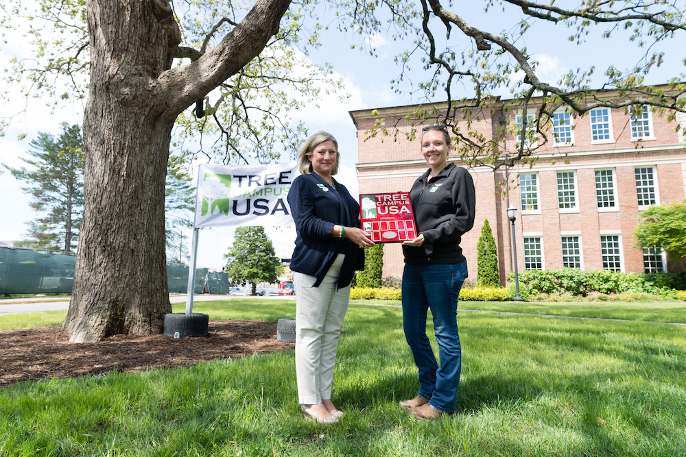 Tennessee Tech provost Lori Bruce and Jaime Nunan with the City of Cookeville display a plaque recoognizing Tech's campus as a 2018 Tree Campus USA by the Arbor Day Foundation for the first time in university history.