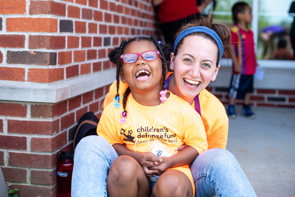 Tennessee Tech graduate student Lindsey Braisted and student Ne'Vaeh Bryant enjoy a laugh during the 2019 Jere Whitson Freedom Schoo, a free, six-week literacy and cultural enrichment program serving kindergarten through fourth grade students from the community.