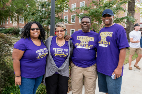 a group of four people wearing Tennessee Tech t-shirts.