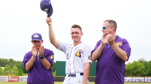 Kevin Strohschein holding his hat up as he completes his Golden Eagle career.