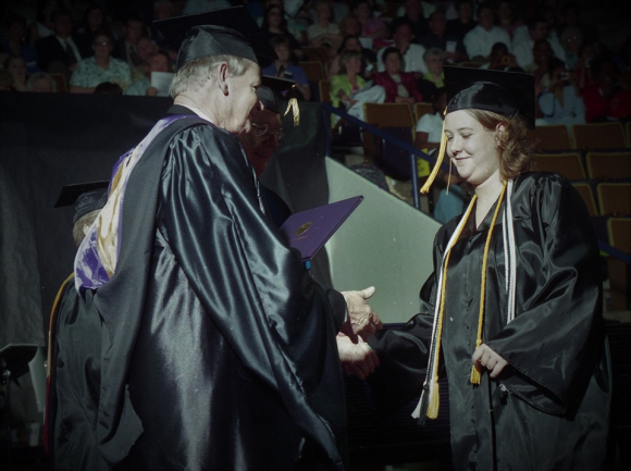 Jennifer Winningham Owens receives diploma from her father