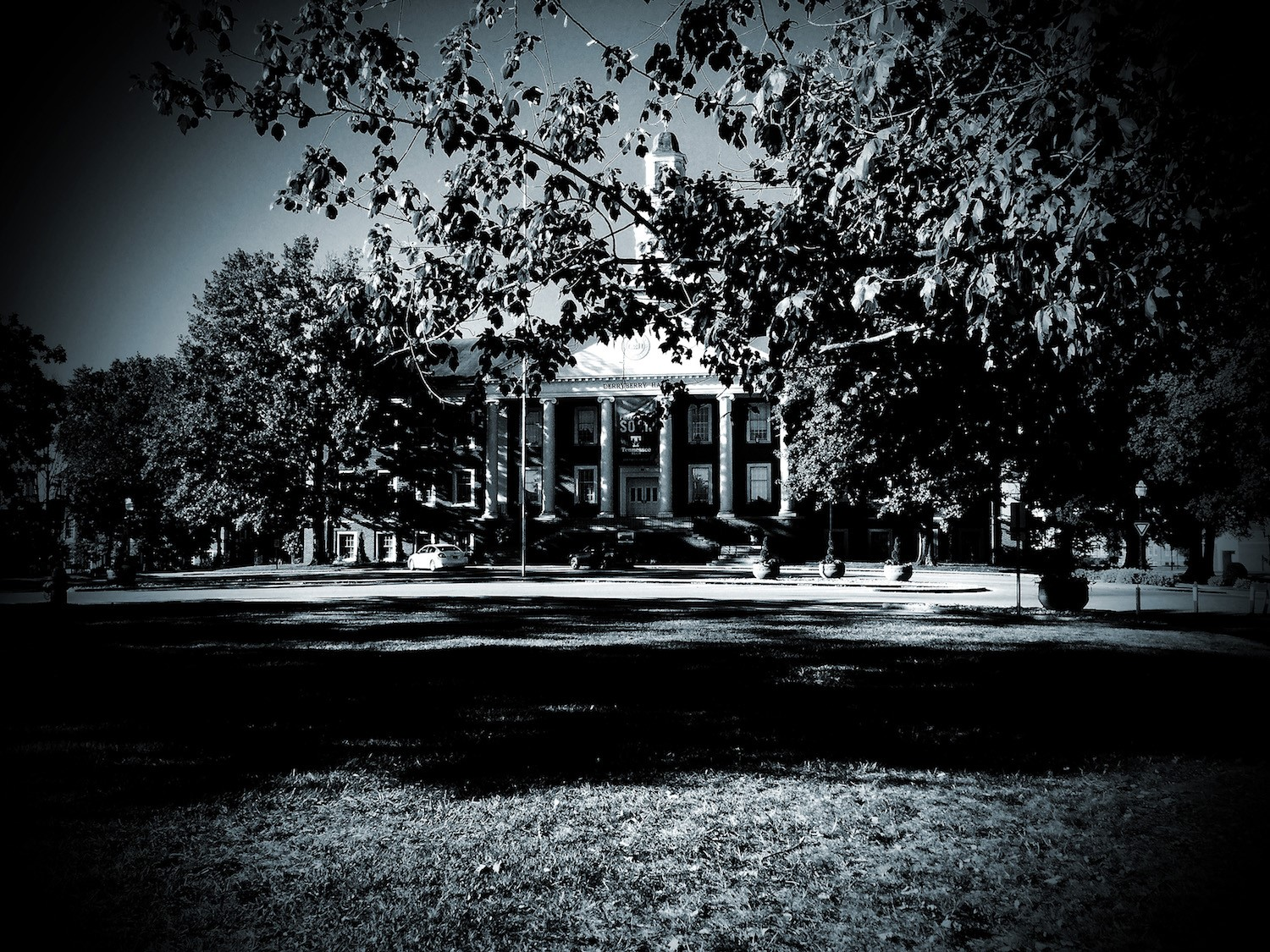 "Black and white photo of Derryberry Hall with an effect to look ""spooky"""