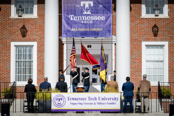 Veterans Day flag ceremony in front of Derryberry Hall